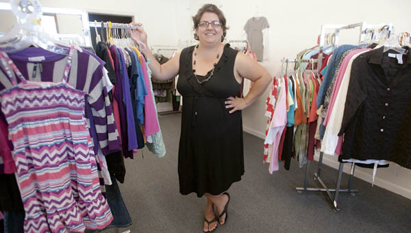 Christine Case stands inside Maxine's Closet Thrift Shop, located along Third Street, in Chesapeake.
