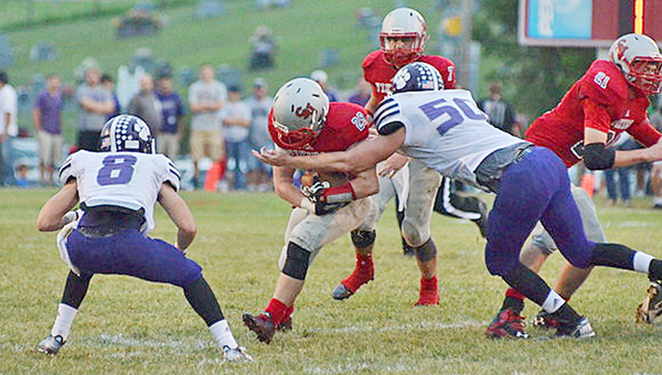 Symmes Valley Vikings' running back Collin Webb (22) tries to run through the tackle of Chesapeake Panthers' linebacker Brad Meadows (50) during last Friday's game. The Vikings travel to Oak Hill this Friday in their SOC opener. (Robert S. Stevens & The Gold Studio of Ironton)