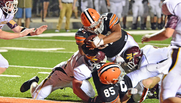 Ironton Fighting Tigers' fullback Desmond Young (32) pounds his way into the end zone for a touchdown during last week's game against Russell. Ironton hosts Kentucky Class A perennial power Beechwood this Friday. (Kent Sanborn of Southern Ohio Sports Photos)