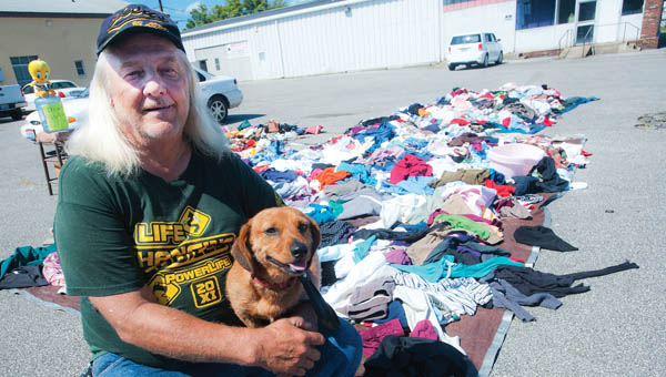 Cecil Oiler, of Raceland, Kentucky, and his dog Killer are on a mission to help anyone who is in need of clothes.