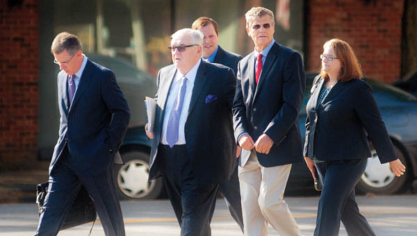Dr. Richard Paulus and his legal team cross Greenup Avenue to the Carl Perkins Federal Building Thursday for Paulus' arraignment.