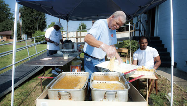 Myron Cofer fries fish during the annual fish fry at the Quinn Chapel AME Church in Ironton.