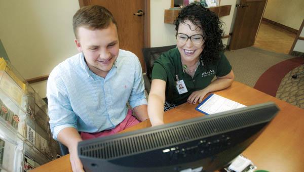 Student ambassador Rachel Swindler with Ohio University Southern is seen assisting Elijah Hamilton.