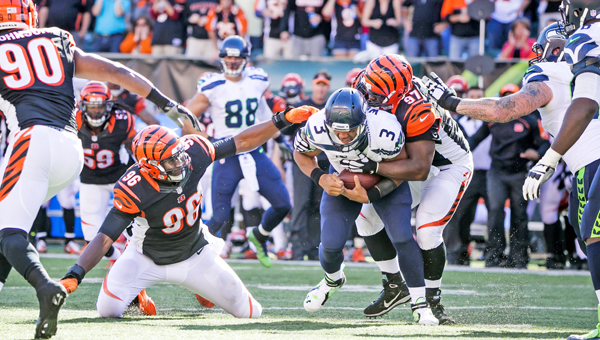 Seattle Seahawks quarterback Russell Wilson is sacked by Cincinnati Bengals' defensive lineman Geno Atkins on third down, forcing a punt with just over two minutes remaining and the Bengals three points behind on Sunday at Paul Brown Stadium in Cincinnati. The Bengals beat the Seahawks 27-24 in overtime. (MCT Direct Photos)
