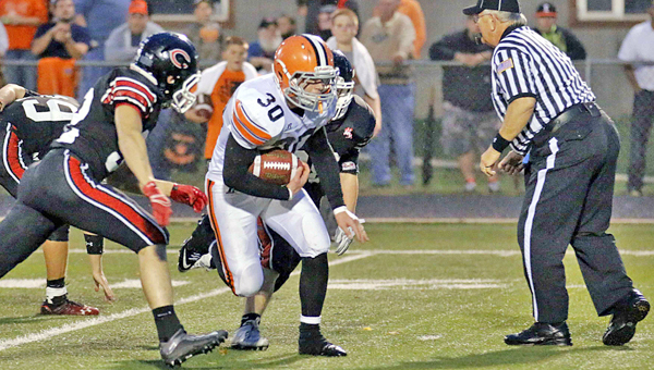 Ironton Fighting Tigers' running back Andrew Barker (30) picks up some big yardage during the winning scoring drive in the fourth quarter on Friday. Ironton beat the Coal Grove Hornets 13-6 in an Ohio Valley Conference battle for first place. (Tim Gearhart of Tim's News & Novelties, Park Ave. in Ironton)