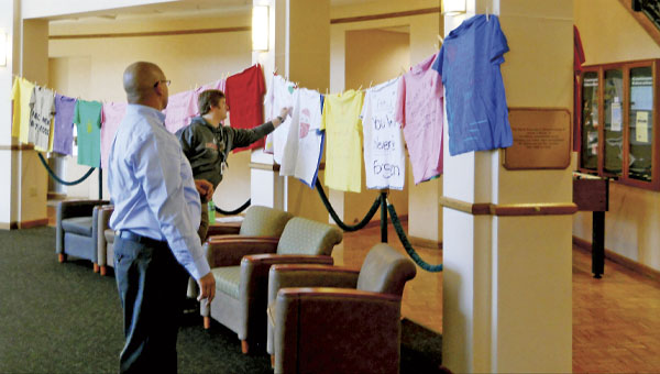 T-shirts hung at Ohio University Southern raise awareness for domestic violence.