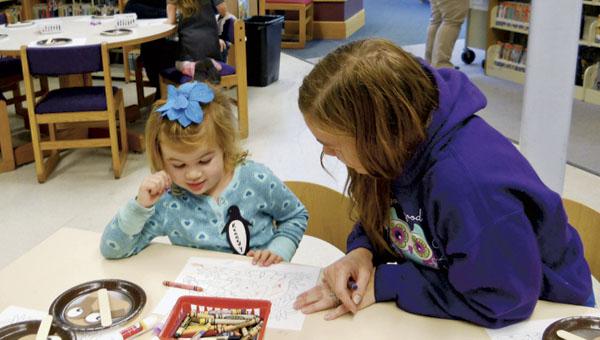 Children enjoying storetime at Briggs Lawrence Library.