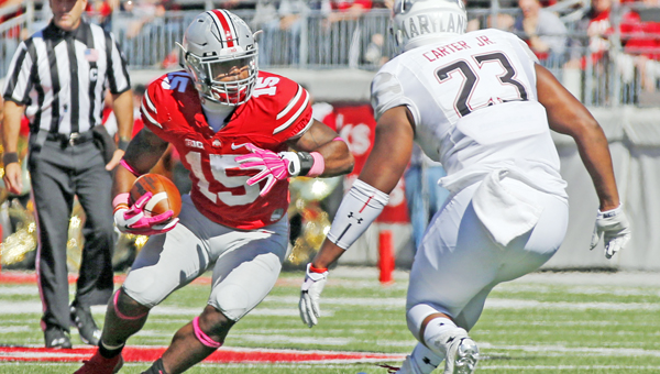 Ohio State running back Ezekiel Elliott (15) says the Buckeyes are staying focused even during this week's bye in the schedule.  (Barbara J. Perenic/Columbus Dispatch/TNS)