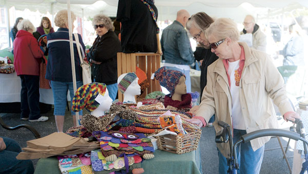 Guests browse through the handcrafted items.
