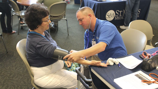 Linda Fraley gets a blood pressure screening Thursday evening at Ohio University Southern during the health fair.