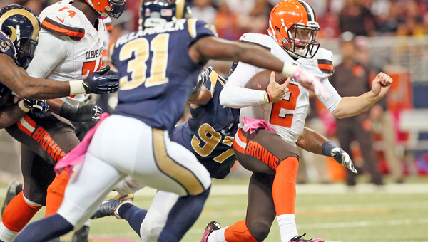 Cleveland Browns' backup quarterback Johnny Manziel runs for a gain against the St. Louis Rams' defense on Sunday. Manziel replaced starter Josh McCown who suffered a shoulder injury late in the game. The Browns lost 24-6. (MCT Direct Photos)