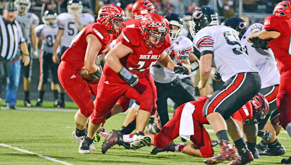 Rock Hill Redmen offensive lineman Matt Murphy (75) looks to make a trap block on a running play during last week's Ohio Valley Conference game against Coal Grove. The Redmen host Portsmouth this Friday. (Kent Sanborn of Southern Ohio Sports Photos)