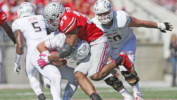 Ohio State linebacker Joshua Perry (37) sacks Maryland quarterback Perry Hills (11) in the third quarter on Saturday at Ohio Stadium in Columbus. The host Buckeyes won, 49-28. (MCT Direct Photo)
