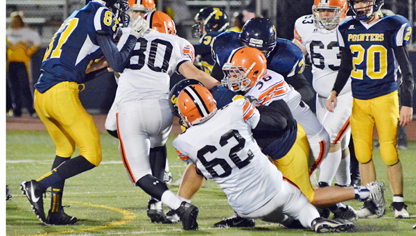 Ironton Fighting Tigers' senior Jack Thompson (62) and junior Travis Gayhart (36) team up to make a tackle during Friday's 35-8 win over the South Point Pointers. Ironton won the Ohio Valley Conference title outright with its sixth straight win. (Robert S. Stevens & The Gold Studio in Ironton)