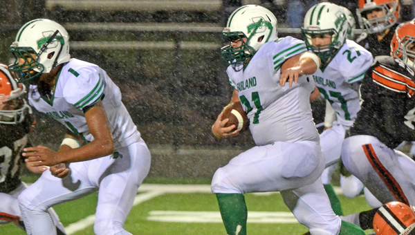 Fairland Dragons' senior fullback Sidney Tucker (21) breaks free for big yardage during a game last week at Ironton. The Dragons host arch-rival Chesapeake on Friday in an Ohio Valley Conference game. (Kent Sanborn of Southern Ohio Sports Photos)