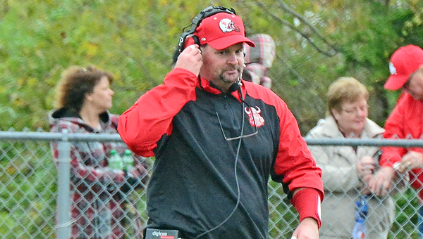 Symmes Valley Vikings' head football coach Rusty Webb talks with one of his assistant coaches on his headphones during Saturday's Southern Ohio Conference game at Beaver Eastern. The Vikings won 42-16 to give Webb his 100th career victory. (Kent Sanborn of Southern Ohio Sports Photos)