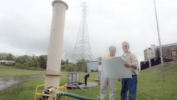 Coal Grove Engineer Paul Amburgey and Coal Grove Mayor Larry McDaniel at the village's water treatment plant.