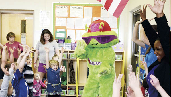 Students at Sybene Preschool dance with Choosy, a mascot who teaches them about healthy eating, as part of the center's parent engagement event on Thursday.