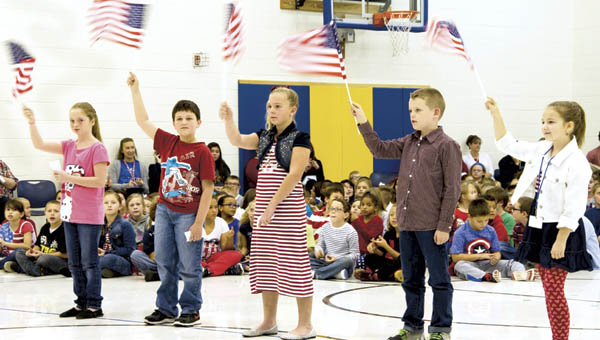 Students perform in the Veterans Day program at Burlington Elementary School on Tuesday.