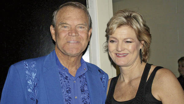 """Debby Campbell with her father, country music legend Glen Campbell, in this photo. She has written a book, """"Glen Campbell: Life With My Father,"""" which details their relationship over the years and the aftermath of his 2011 diagnosis with Alzheimer's Disease."""