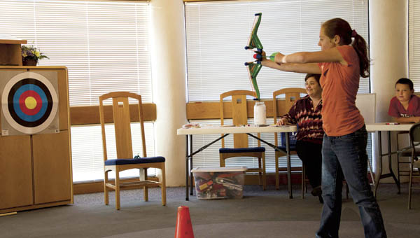 Teens and tweens take part in the Hunger Games Arena Challenge at the South Point branch of the Briggs Lawrence County Public Library on Monday.