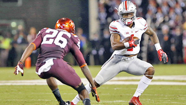 Running back Braxton Miller (1) is one of the key seniors who has helped in the Ohio State Buckeyes turnaround during coach Urban Meyer's tenure. (Courtesy of Ohio State Buckeyes.com)