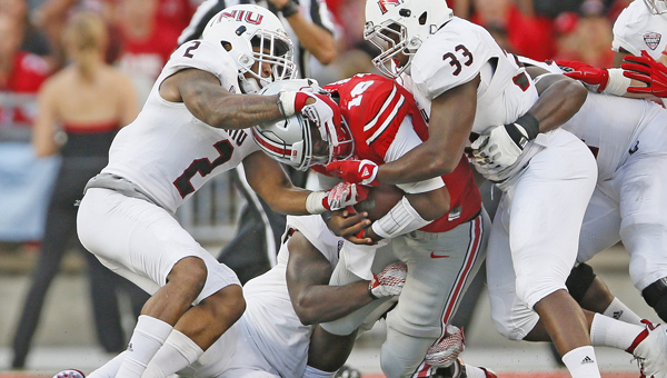 Ohio State Buckeyes' quarterback J.T. Barrett (16) will forfeit his summer financial aid as part of his penalty for being arrested early Saturday morning on an operating a vehicle while impaired charge. Barrett has also been suspended for this Saturday's game against Minnesota. (Adam Cairns/Columbus Dispatch/TNS)
