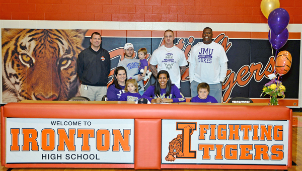 Ironton Lady Fighting Tigers' senior basketball standout Lexie Barrier signed a national letter-of-intent on Thursday to play at James Madison University. Attending the ceremony were: seated from left to right, mother Rachel Meadows, Lexie and brother Brady; standing from left to right, Ironton head coach Doug Graham, step-father Jeremy Meadows, brother Kingston, AAU coach Scott Johnson and father David Kidd. (Kent Sanborn of Southern Ohio Sports Photos)