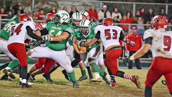 Rock Hill Redmen defensive lineman Cameron Haas (53) prepares to bring down Fairland running back Sidney Tucker (21) during last week's game. Rock Hill plays at Albany Alexander at 7:30 p.m. on Friday in the Division V Region 17 playoffs. (Kent Sanborn of Southern Ohio Sports Photos)