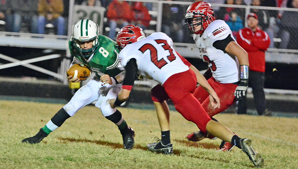 Rock Hill's Heath Carpenter (23) sacks Fairland Dragons' quarterback Joel Lambiotte (8) during last Friday's game. Rock Hill will play in the Division V Region 17 postseason playoffs on Friday at 7:30 p.m. at Albany Alexander. (Kent Sanborn of Southern Ohio Sports Photos)