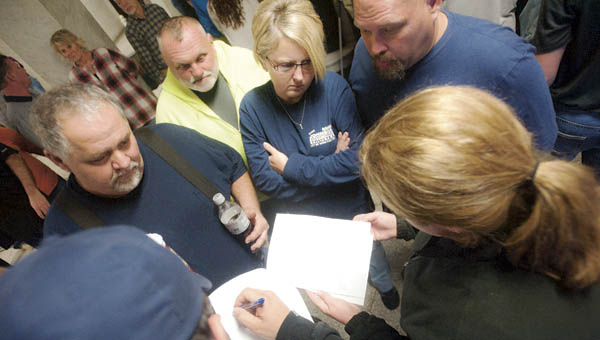 Area residents gathered inside the Lawrence County Courthouse Tuesday evening as they go through election results.