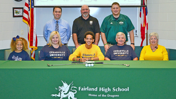Fairland Dragons' senior golfer signed a letter-of-intent on Thursday to play at Cedarville University. Attending the signing ceremony were: seated from left to right, sister Isabella, mother Summer James, Hayden James, grandfather Ron James and grandmother Jackie James; standing from left to right, Fairland principal Chad Belville, Dragons' golf coach Bryan Ward and athletic director Jeff Gorby. (Kent Sanborn of Southern Ohio Sports Photos.com)