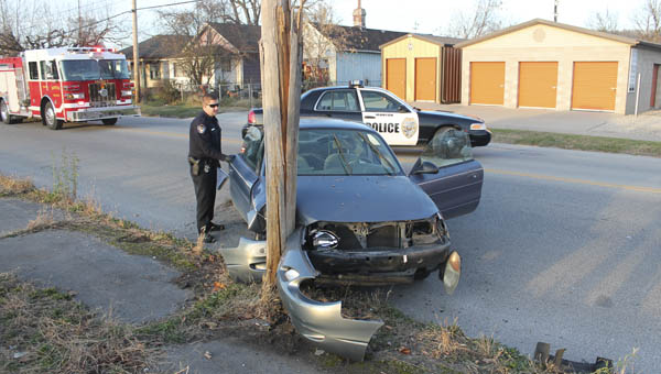 Ironton police, fire and EMS respond to a single car crash after it hit a telephone pole Tuesday afternoon traveling southbound on South Third Street.