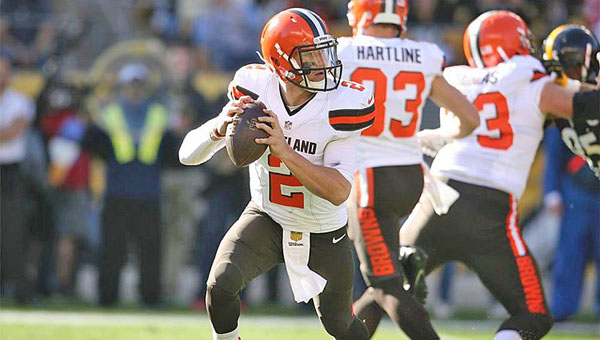 Cleveland Browns' quarterback Johnny Manziel rolls out against the Pittsburgh Steelers' defense during Sunday's game. Manziel was 33-of-45 for 372 yards and a touchdown but the Browns lost their fifth straight game, 30-9. (Photo Courtesy of The Cleveland Browns.com)