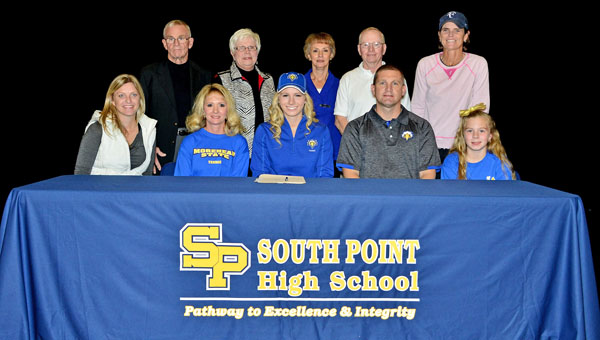 South Point Lady Pointers' senior tennis standout Madison Riley signed a letter-of-intent on Wednesday to play at Morehead State University. Attending the ceremony were: seated from left to right, coach Julie Ditty, mother Kim Riley, Madison, father Eric Riley and sister Meredith Riley; standing from left to right, grandparents Gordon and Sandy Riley and grandparents Betty and Ron Cade, and coach Laurie Mercer. (Kent Sanborn of Southern Ohio Sports Photos)