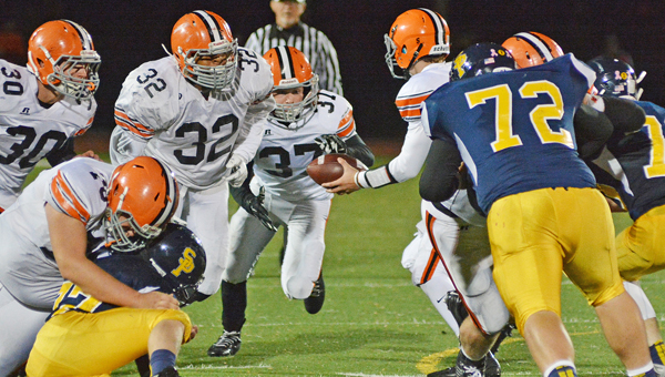 Ironton Fighting Tigers' running back Chase Rowe (37) takes a handoff and follows the blocks of Hayden Robinson (76) and Desmond Young (32). Ironton plays at 7:30 p.m. on Friday at Wheelersburg in the Division V Region 17 quarterfinals. (Robert S. Stevens & The Gold Studio of Ironton)