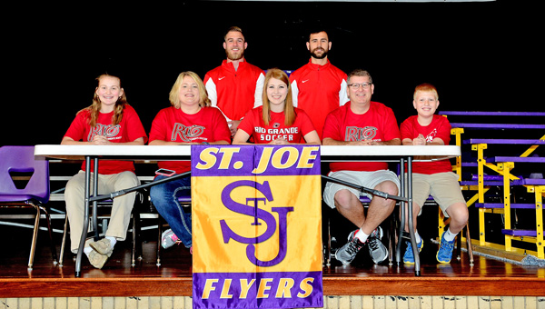 St. Joseph Female Flyers' senior soccer standout Emma Saxby signed a letter-of-intent to play at the University of Rio Grande. Attending the ceremony were: seated from left to right, sister Megan Saxby, mother Lisa Saxby, Emma, father Dr. Richard Saxby and brother Jacob Saxby; standing from left to right, Rio Grande coaches Austin Wilson and Craig Davies. (Kent Sanborn of Southern Ohio Sports Photos)