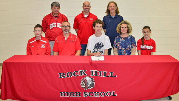 Rock Hill Redmen senior Seth Miller signed a letter-of-intent to run cross country at Shawnee State University. Attending the ceremony were: seated from left to right, brother Ethan Miller, father Mike Miller, Seth, mother Marisa Miller and sister Camryn Miller; standing from left to right, assistant Rock Hill cross country coach Dave Brammer, Rock Hill cross country head coach Mark McFann and Shawnee State head coach Eric Putnam. (Kent Sanborn of Southern Ohio Sports Photos)