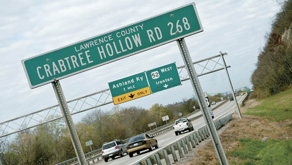 Motorists travel along westbound U.S. 52 mid morning on Wednesday. This January the Ohio Department of Transportation will take bids for the construction of barrier walls along the highway. The walls will keep future rockslides at bay.