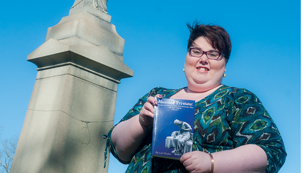 """Ironton resident and librarian Lori Shafer displays her local literary tribute named """"Haunted Tri-State."""" Her book features strange and unusual stories from around Kentucky, Ohio and West Virginia."""