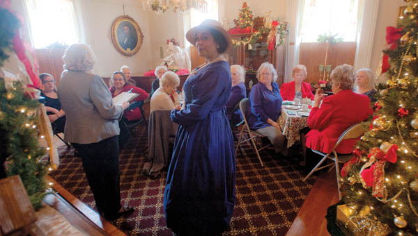 Jackie Dufore plays the part Lavina Ditcher during the Holiday Tea event at the Lawrence County Museum Saturday.