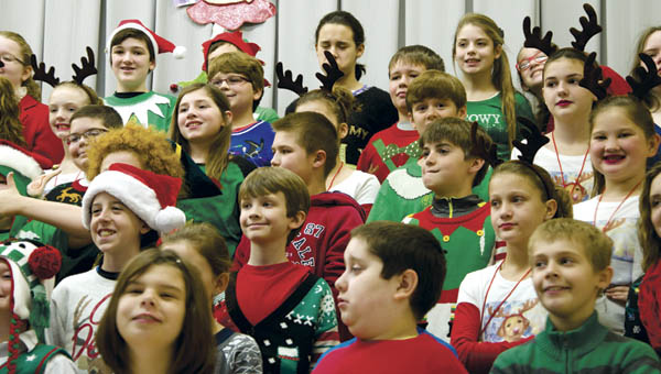 """Fifth grade students at Fairland West Elementary rehearse """"Crazy Carols,"""" as part of the school's annual Christmas program on Tuesday."""