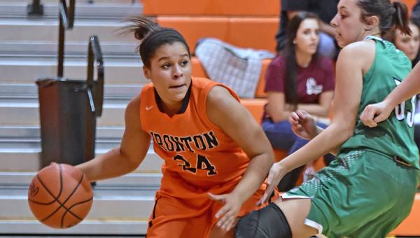 Ironton Lady Fighting Tigers' Alyssa Lewis (24) looks to drive past Fairland Lady Dragons' defender Tori Hall (33) during Monday's Ohio Valley Conference game. Ironton won 68-26. (Kent Sanborn of Southern Ohio Sports Photos.com)