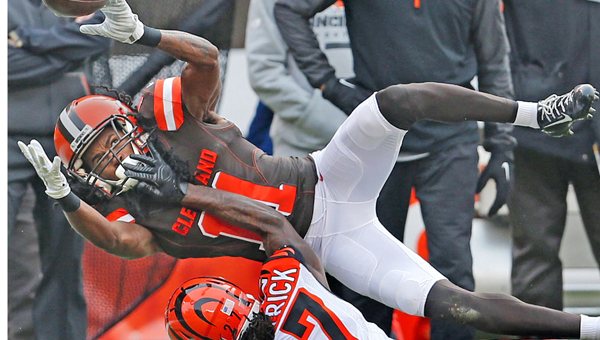 Cleveland wide receiver Travis Benjamin can't hold onto a pass from quarterback Austin Davis as Cincinnati cornerback Dre Kirkpatrick covers him during the first quarter on Sunday. The Bengals won 37-3. (Ed Suba Jr./Akron Beacon Journal/TNS)