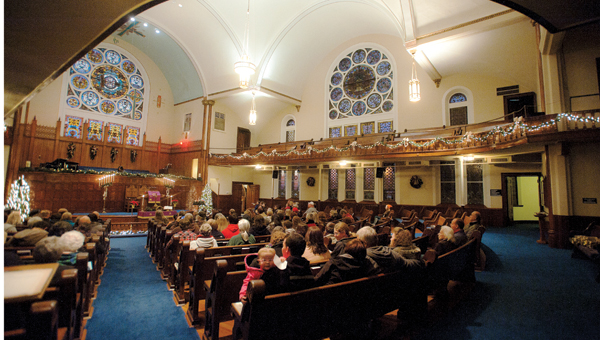 Participants of the annual church walk gather inside First United Methodist Church on Saturday.