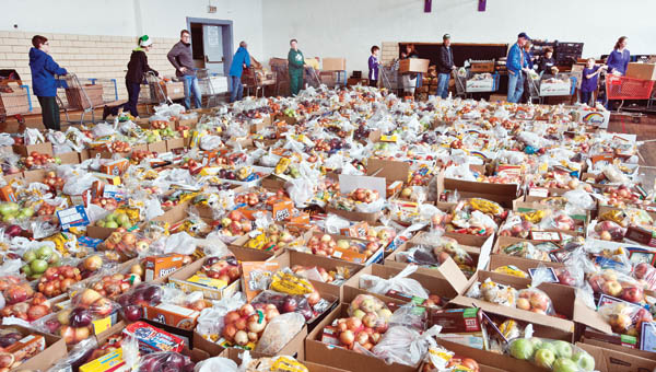 Volunteers gathered in the gymnasium of the Chesapeake Community Center, surrounded by more than 500 food baskets on Tuesday. The baskets were given out to area residents in need.