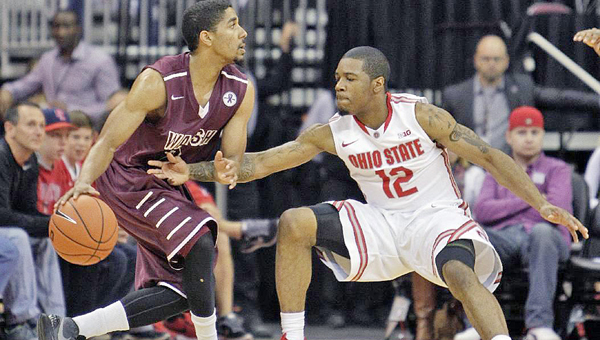 Walsh junior and former Ironton All-Ohio guard and Fighting Tigers' all-time leading scorer Zac Carter (left) looks for an opening against Ohio State during a preseason exhibition game in which Carter scored 21 points. (Photo courtesy of Walsh University)