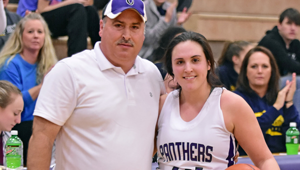Chesapeake Lady Panthers' senior center Kaylee Curry recorded her 1,000th career point on Wednesday. Curry needed 19 coming into the game to reach the milestone. The Lady Panthers beat South Point 61-51 to win the Lady Peake Holiday Tournament. ABOVE: Curry with her father Mark celebrate the milestone. (Kent Sanborn of Southern Ohio Sports Photos)