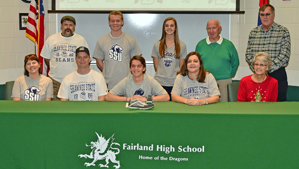 Fairland Dragons' senior cross country runner Conner Flynn signed a letter-of-intent to run at Shawnee State University next fall. Attending the ceremony were: seated from left to right, aunt Wendy Carter, father Jason Flynn, Conner, mother Jana Flynn and grandmother Karen Flynn; standing from left to right, uncle Keith Carter, brother Thayer Flynn, sister Maddi Flynn, grandfather Charlie Workman and grandfather Jim Thayer. (Kent Sanborn of Southern Ohio Sports Photos)