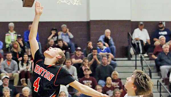 Ironton Fighting Tigers' senior guard Phil Kratzenberg (4) drives past the Ashland Tomcats' defense for two points. Kratzenberg scored 29 points in a 57-55 loss on Friday. (Tim Gearhart of Tim's News & Novelties, Park Ave. in Ironton)